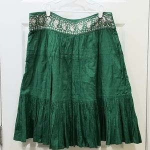Green sequined broomstick skirt